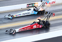 Oct 12, 2019; Concord, NC, USA; NHRA top fuel driver Doug Kalitta (near) races alongside Justin Ashley during qualifying for the Carolina Nationals at zMax Dragway. Mandatory Credit: Mark J. Rebilas-USA TODAY Sports