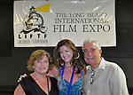 Bellmore, New York, United States. July 10, 2015. At center, MARISA VITALI, the Co-Producter, Writer and an Actor in the short film GRACE, poses with her mother HEATHER VITALI and father EVERETT VITALI, at the the Official Opening Night Reception and Technical Awards presentation of LIIFE, Long Island International Film Expo, in the Filmmakers Lounge. Grace is about a woman fighting her ex-husband for custody of their daughter. LIIFE events, including screenings nextdoor at Bellmore Movies, panels, and ceremonies, span from July 8 through July 16.