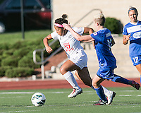 In a National Women's Soccer League Elite (NWSL) match, the Boston Breakers defeated the FC Kansas City, 1-0, at Dilboy Stadium on August 10, 2013.  FC Kansas City midfielder Desiree Scott (11) and Boston Breakers midfielder Joanna Lohman (11) compete for the ball.