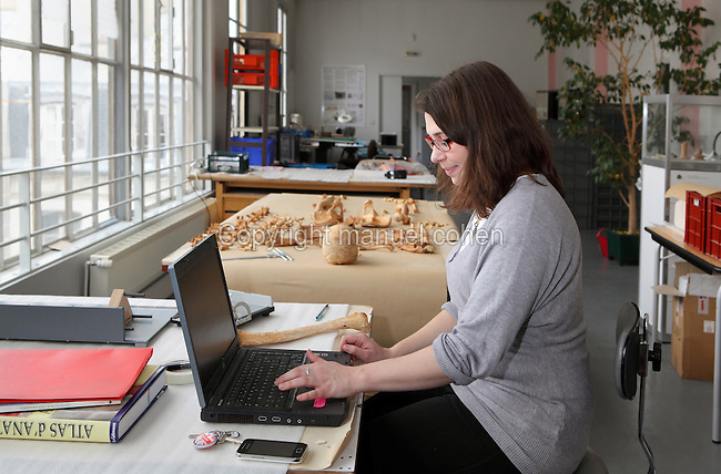 Archeo-anthropologist Sabrina Parot working on April 08, 2013 in her laboratory in Departement Histoire de l'Architecture et Archeologie de Paris et secretariat de la Commission du Vieux Paris (Architecture and Archeology of Paris History Department), Paris, France. Sabrina Parot is showing and manipulating a skull and bones excavated from the Romanesque church Saint Germain de Charonnes. Researches are actually presuming that the skeleton is dating back to Middle Ages. Picture by Manuel Cohen