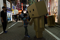 A little boy shakes the hand of someone wearing a cardboard robot costume during the Halloween celebrations Shibuya, Tokyo, Japan. Saturday October 27th 2018. The celebrations marking this event have grown in popularity in Japan recently. Enjoyed mostly by young adults who like to dress up, drink , dance and misbehave in parts of Tokyo like Shibuya and Roppongi. There has been a push back from Japanese society and the police to try to limit the bad behaviour.