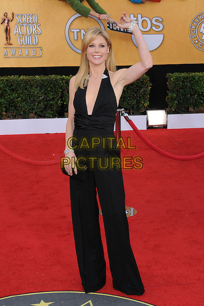 JULIE BOWEN .at the 17th Screen Actors Guild Awards held at The Shrine Auditorium in Los Angeles, California, USA, .January 30th 2011..SAG Sags arrivals full length black pantsuit jumpsuit catsuit halterneck clutch bag low cut hand waving arm .CAP/RKE/DVS.©DVS/RockinExposures/Capital Pictures.