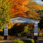 Arch over road to Camden, Maine, USA