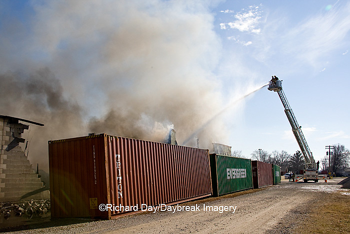 63818-022.05 Firefighters extinguishing warehouse fire using aerial ladder truck, Salem, IL