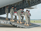 A transfer case containing the remains of Staff Sergeant Michael H. Ollis, United States Army, are carried off a transport plane as they are transferred by an Army transfer team during a Dignified Transfer ceremony at Dover AFB in Dover, Delaware on Saturday, August 31, 2013.  Ollis died supporting Operation Enduring Freedom in Afghanistan.<br /> Credit: Ron Sachs / CNP<br /> (RESTRICTION: NO New York or New Jersey Newspapers or newspapers within a 75 mile radius of New York City)