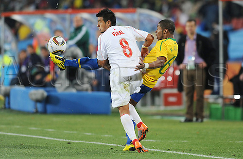 Michel Bastos of Brazil fights for the ball with Arturo Vidal of Chile during the 2010 FIFA World Cup soccer match between Brazil and Chile at Ellis Park Stadium on June 28, 2010 in Johannesburg, South Africa.