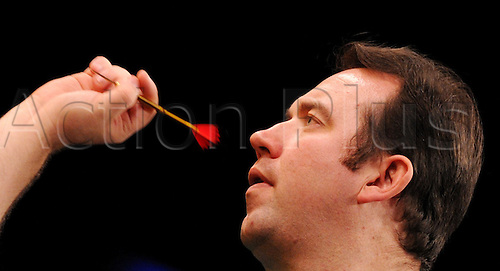 04.02.2012. Hamburg, Germany.  Northern Ireland's Brendan Dolan competes in the Darts World Cup 2012 at the Alsterdorfer Sports Hall in Hamburg, Germany. players from the top 24 countries are fighting for the world cup title.