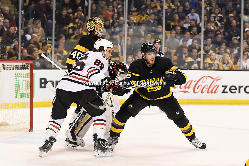 Thursday, March 3, 2016: Chicago Blackhawks center Andrew Shaw (65) and Boston Bruins defenseman Kevan Miller (86)  battle for space in front of goalie Tuukka Rask (40) during the National Hockey League game between the Chicago Blackhawks and the Boston Bruins, held at TD Garden, in Boston, Massachusetts. Boston defeated Chicago 4-2. Eric Canha/CSM