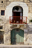 Marsaxlokk, Malta.  1806 Doorway, Balcony, Flowers facing the harbor.