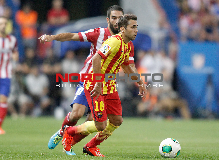 Atletico de Madrid's Arda Turan (l) and FC Barcelona's Jordi Alba during Supercup of Spain 1st match.August 21,2013. Foto © nph / Acero)