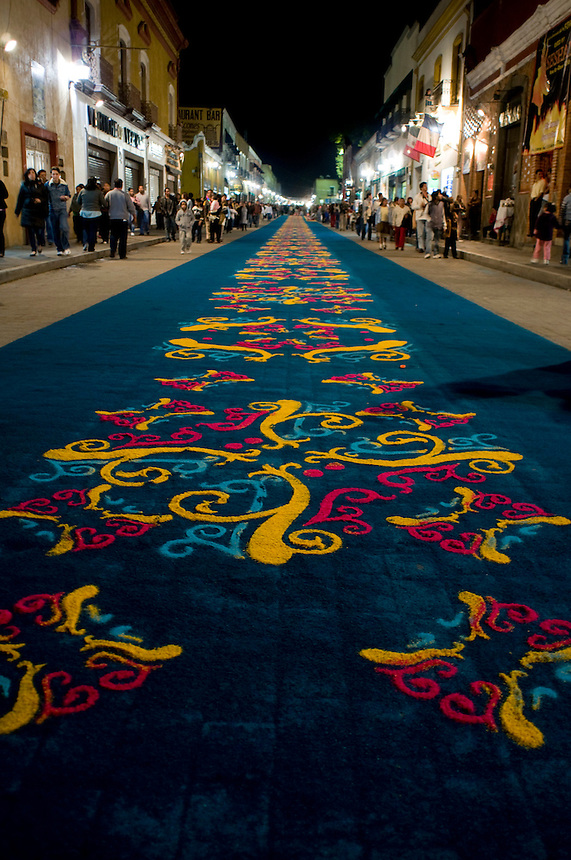 Making of the sawdust carpets and related festivities in honor of its virgin saint.