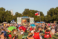 The Texas flag proudly flies in the wind at Austin's Blues on the Green, a popular free summertime concert series that features some of the best blues and rock singers in Texas and is listed as one of Austin's best summer music events.