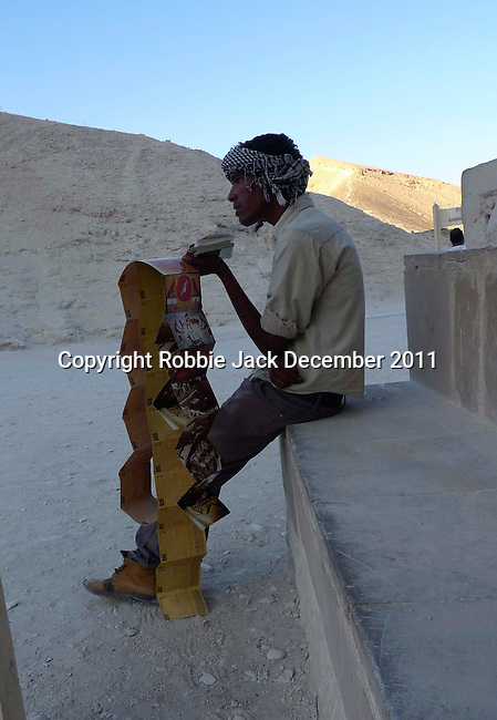 Young man selling postcards in the Valley of the Kings at Thebes.Thebes is the name the Greeks gave to Waset, the ancient capital of Egypt.