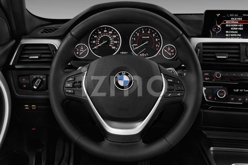 Car pictures of steering wheel view of a 2016 BMW 3-Series 328i-xDrive-Sports-Wagon 5 Door Wagon Steering Wheel
