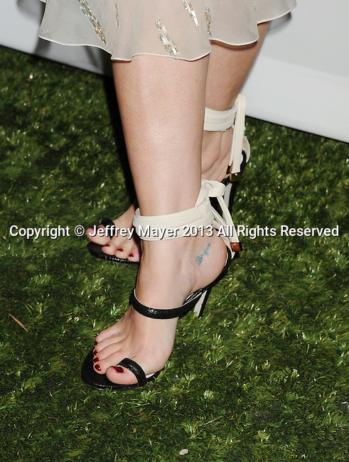 CULVER CITY, CA- NOVEMBER 09: Actress/model Jaime King (shoe, tattoo detail) at the 2nd Annual Baby2Baby Gala at The Book Bindery on November 9, 2013 in Culver City, California.