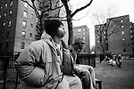 "BROOKLYN -- FEBRUARY 07, 2009:  Rapper Equan ""Aimz"" Jones, 19, sits on a bench with his friend ""Play"" in a courtyard at the Vanderveer Estates apartment complex on February 07, 2009 in Brooklyn. (PHOTOGRAPH BY MICHAEL NAGLE)."