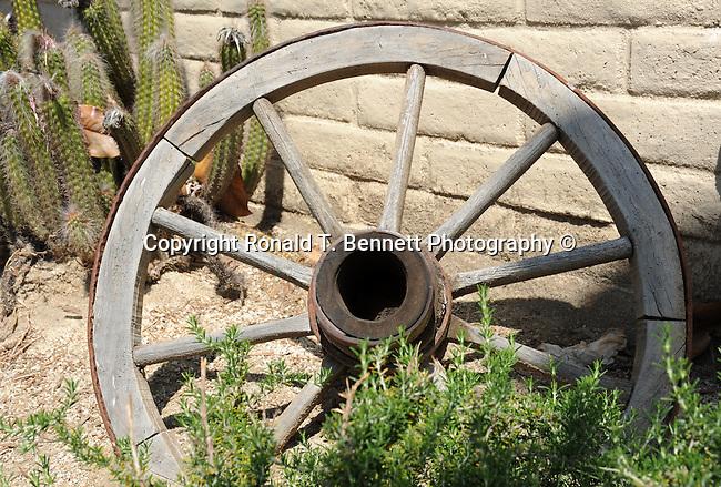 Wagon wheel and cacti,
