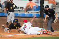 Johnson City Cardinals starting pitcher Josh Wirsu (28) makes a diving tag on Logan Ratledge (25) of the Bristol Pirates as home plate umpire Kaz Endo looks on at Howard Johnson Field at Cardinal Park on July 6, 2015 in Johnson City, Tennessee.  The Pirates defeated the Cardinals 2-0 in game one of a double-header. (Brian Westerholt/Four Seam Images)