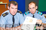 ALERT: Tralee Gardai Tom Barry on left and John O'Donoghue demonstrating how to recognise fake notes.   Copyright Kerry's Eye 2008