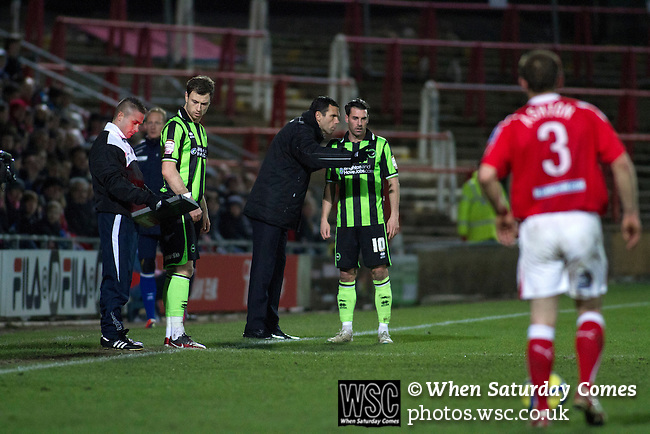 Wrexham 1 Brighton & Hove Albion 1, 18/01/2012. Racecourse Ground, FA Cup 3rd Round Replay. Visiting manager Gus Poyet (centre) tissuing instructions to one of his players at the Racecourse Ground, as Wrexham hosted Brighton and Hove Albion in an FA Cup third round replay, played following the teams one-all draw in the first match. The replay was won by Brighton, 5-4 on penalty kicks after the match had ended in a one-all draw after extra time, watch by a crowd of 8316. The visitors played in the Championship, three leagues above their rivals from Wales, who were top of the Conference at the time of the match. Photo by Colin McPherson.