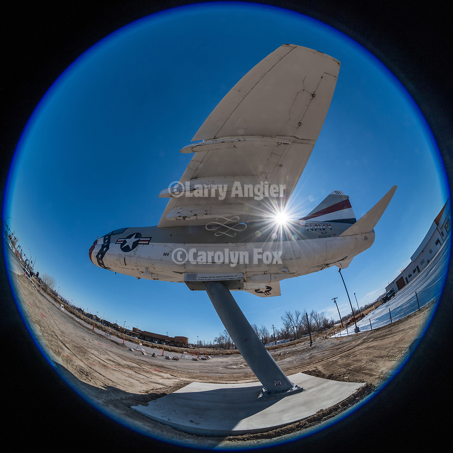 Navy A7 aircraft on a pillar with sunburst, Fallon, Nevada