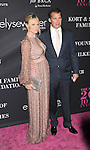SANTA MONICA, CA- OCTOBER 18: Actress/model Molly Sims (L) and husband/producer Scott Stuber attend Elyse Walker presents the 10th anniversary Pink Party hosted by Jennifer Garner and Rachel Zoe at HANGAR 8 on October 18, 2014 in Santa Monica, California.