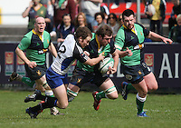 AIB Cup Final 2009. Hinch flanker Michael Graham on the attack is tackled by Evan Ryan during the AIB Cup Final against Cork Con at Dubarry Park, Athlone. Mandatory Credit - Mandatory Credit - John Dickson