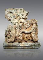 Roman Sebasteion relief  sculpture of Poseidon and Amphitrite,  Aphrodisias Museum, Aphrodisias, Turkey. <br /> <br /> The two god-like tritons, Poseidon and Amphitrite, are seated on two sea horses accompanied by two fish legged tritons below. Between the tritons sits a sea-putto of baby triton. The male god is in the form of Poseidon crowned by his wife Amphitrite. Unusually he wears a military cloak and they might be an emperor and his wife (such as Claudius and Agrippina) in the guise of Poseidon and Amphitrite