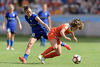 Houston, TX - Saturday May 27, 2017: Rumi Utsugi trips up Andressa (17) of the Houston Dash while going for the ball during a regular season National Women's Soccer League (NWSL) match between the Houston Dash and the Seattle Reign FC at BBVA Compass Stadium.