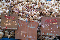 Garlic for sale at a market in Cours Belsunce, Marseille, Provence, France.