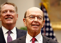 United States Secretary of Commerce Wilbur L. Ross, Jr. (right) and US Trade Representative Robert Lighthizer share a laugh prior to US President Donald J. Trump announcing David Malpass as his choice to lead the World Bank, in the Roosevelt Room of the White House, Washington, DC, February 6, 2019. Photo Credit: Martin H. Simon / CNP/AdMedia