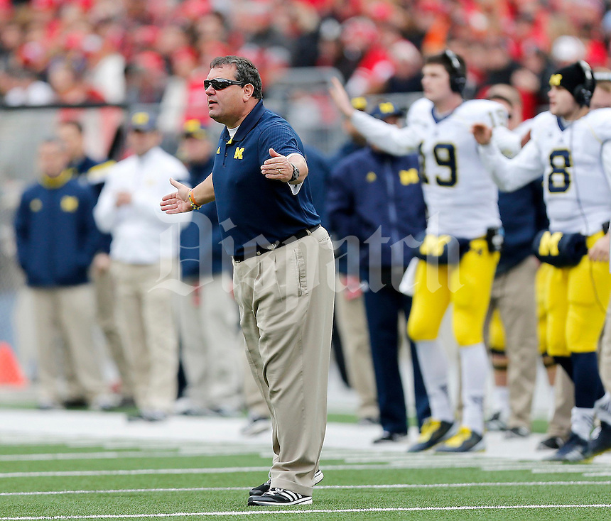 Michigan Wolverines head coach Brady Hoke talks to the referees during the second quarter of the NCAA football game against Michigan at Ohio Stadium on Saturday, November 29, 2014. (Columbus Dispatch photo by Jonathan Quilter)