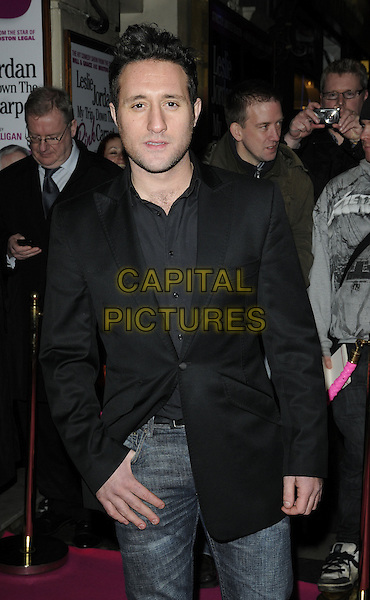 ANTONY COSTA.Press night for 'My Trip Down The Pink Carpet' at the Apollo Theatre, Shaftesbury Avenue, London, England..February 3rd 2011.half length black suit jacket.CAP/CAN.©Can Nguyen/Capital Pictures.