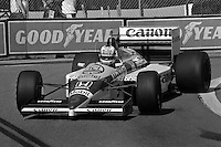 DETROIT, MI - JUNE 22: Nigel Mansell of Great Britain drives the Williams FW11/Honda RA166E during the Detroit Grand Prix FIA Formula One World Championship race on the Detroit Street Circuit in Detroit, Michigan, on June 22, 1986.