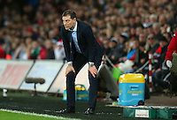 West Ham United manager Slaven Bilic on his haunches during the Barclays Premier League match between Swansea City and West Ham United played at The Liberty Stadium, Swansea on 20th December 2015