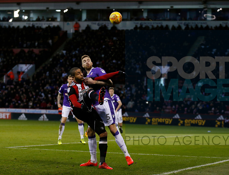 Leon Clarke of Sheffield Utd lifts the ball over Mark Beevers of Bolton Wanderers during the Championship match at Bramall Lane Stadium, Sheffield. Picture date 30th December 2017. Picture credit should read: Simon Bellis/Sportimage