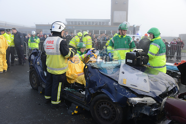 The scene of carnage at the crash demonstration by members of the emergency services at St. Oliver's Community College this morning. Photo: Andy Spearman www.newsfile.ie..There were scenes of carnage at St. Oliver's Community College this morning.  Several transition year students were cut from crashed cars and carried to waiting ambulances leaving others lying in body bags in the school yard...Thankfully this scene was not for real but a very graphic demonstration of the aftermath of a road traffic accident and the importance of driving with care given by the Garda Siochana, The Fire service, the Ambulance Service and a medical team from the Lourdes Hospital Drogheda...The Gardai and the Ambulance services demonstrated the importance of driving with care, obeying the speed limits, not drinking or taking drugs and driving...The students were shown images of the consequences when road safety is not taken into account and were also made aware of what can occur if they get into a car with someone who is not going to obey the rules of the road and the effect this can have on the families involved...The various services then simulated a road crash scene in the school yard which was extremely well presented and the students where able to see the catastrophic effects of a crash on victims, the man power and services needed to deal with an accident, how the services interact with each other at the scene, the equipment needed and the amount of time it takes to deal with a crash...The students benefited greatly from the awareness day and spoke highly of the expertise displayed. Not only did it raise awareness of Road Safety but the students gained an insight into the background knowledge of the professions involved and whether they might be interested in any of these as a future career.  .Picture: Andy Spearman/www.newsfile.ie.The scene of carnage at the crash demonstration by members of the emergency services at St. Oliver's Community College this morning. Photo: Andy Spearm