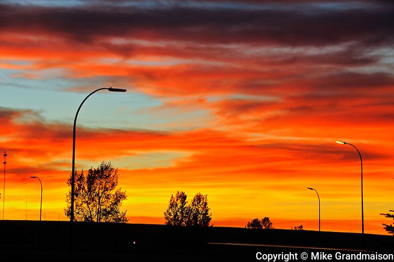 Blazing sky at sunrise on Trans Canada Highway<br /> Swift Current<br /> Saskatchewan<br /> Canada