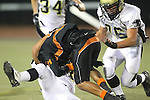 Beverly Hills, CA 09/23/11 - Brandon Canky (Peninsula #11), Frank Brown (Beverly Hills #4) and Justin Evans (Peninsula #76) in action during the Peninsula-Beverly Hills Varsity football game.