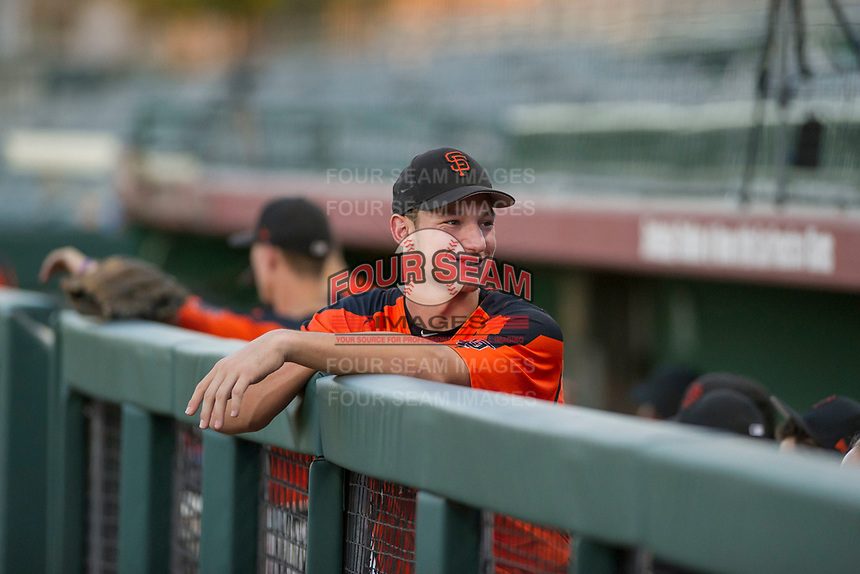AZL Giants 2017 Draft Pick Jacob Gonzalez (52) hangs out in the dugout prior to a game against the AZL Rangers on August 22 at Scottsdale Stadium in Scottsdale, Arizona. AZL Rangers defeated the AZL Giants 7-5. (Zachary Lucy/Four Seam Images via AP Images)