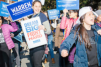 Jessica Landers (left) and other supporters of Democratic presidential candidate and Massachusetts senator Elizabeth Warren gather along Linnaean Street as the candidate walks to Graham & Parks School to vote in the Massachusetts primary as part of Super Tuesday voting in Cambridge, Massachusetts, on Tue., March 3, 2020. The polling place is just a few blocks from Warren's residence. Polls show Warren and Vermont senator Bernie Sanders in a near tie in the Massachusetts Democratic party primary.
