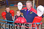 BOXING CLEVER: Listowel Boxing Club members Niall O'Sullivan and Donnacha Brosnan who won medals at the Munster Boy 1 finals on St Patrick's Day, with their coach, John Regan.
