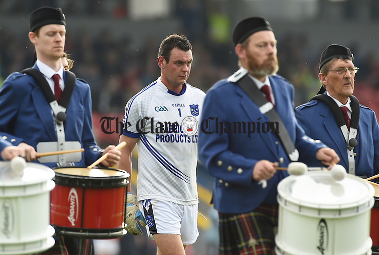 Cratloe captain Pierce DeLoughrey leads his team  behind the band before their county final against Kilmurry Ibrickane in Cusack park. Photograph by John Kelly.