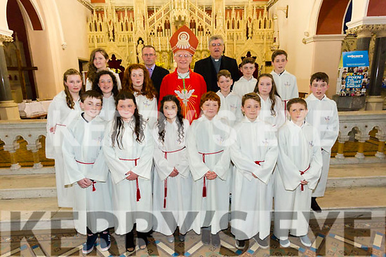 The pupils from Cromane NS with Teacher Kevin Corkery Bishop Ray Browne and Fr Michael Fleming at their Confirmation in St James church, Killorglin on Tuesday