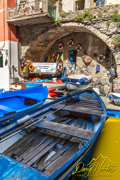 Old fishing boat in an old fishing village, Riomaggiore Italy