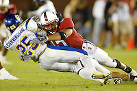 Jared Newberry tackles Clarence Cunningham during Stanford's 63-26 win over San Jose State on September 14, 2002 at Stanford Stadium.<br />Photo credit mandatory: Gonzalesphoto.com