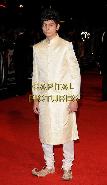 AQIB KHAN.The 'West Is West' premiere, Day 7 of the London Film Festival, Leicester Square, London, England..October 19th, 2010.full length beige gold white jacket top trousers shoes curled toe elf aladdin.CAP/CAN.©Can Nguyen/Capital Pictures.
