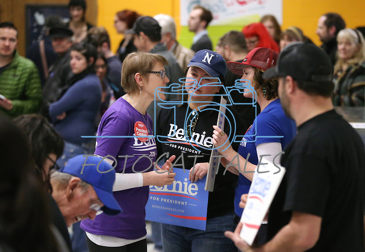 Bernie Sanders supporters, from left center, Kimberly Roberts, Tina Davis and Kellan Adams talk at the Democratic Caucus at Libby Booth Elementary School, in Reno, Nev. on Saturday, Feb. 20, 2016. Cathleen Allison/Las Vegas Review-Journal