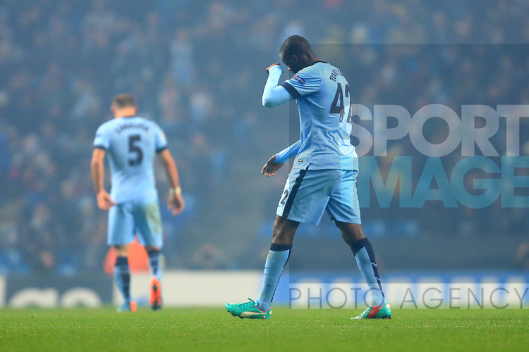 Yaya Toure of Manchester City heads for the changing rooms after his red card - Manchester City vs. CSKA Moscow - UEFA Champions League - Etihad Stadium - Manchester - 05/11/2014 Pic Philip Oldham/Sportimage