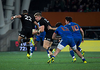 NZ's Richie Mo'unga leaps in support of Jack Goodhue during the Steinlager Series international rugby match between the New Zealand All Blacks and France at Forsyth Barr Stadium in Wellington, New Zealand on Saturday, 23 June 2018. Photo: Dave Lintott / lintottphoto.co.nz